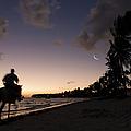 Riding On The Beach by Adam Romanowicz