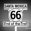 Route 66 Sign In Santa Monica In Black And White by Paul Velgos