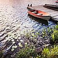 Rowboat At Lake Shore At Sunrise by Elena Elisseeva
