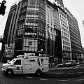 Saint Vincent Catholic Medical Centre Ambulance Crossing 6th Avenue And Broadway by Joe Fox