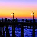 Santa Monica Pier Sunset Silhouettes by Lynn Bauer