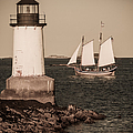 Schooner sailing into harbor