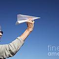 Senior woman with paper plane Print by Konstantin Sutyagin
