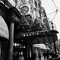shoppers walk past entrance to Macys department store on Broadway and 34th street at Herald square by Joe Fox