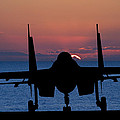 Silhouette Of Military Attack Aircraft Against Vibrant Sunset Sk by Matthew Gibson