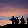 Silhouette Of Modern Troops In Middle East Silhouette Against Be by Matthew Gibson