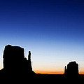 Silhouette Of The Mitten Buttes In Monument Valley  by Susan Schmitz