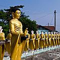 Statue Of Buddha And Disciples Are Alms Round by Tosporn Preede