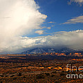Storm Over The La Sals by Mike  Dawson