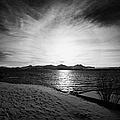 sun setting with halo over snow covered telegrafbukta beach Tromso troms Norway europe by Joe Fox