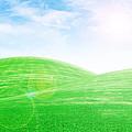 sunrise over green grass hills Print by Thanapol Kuptanisakorn