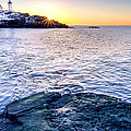 Sunrise Starburst Over Nubble Lighthouse  by Thomas Schoeller