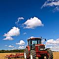 Tractor In Plowed Field by Elena Elisseeva