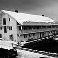 traditional wooden warehouse in Honningsvag harbour finnmark norway europe by Joe Fox