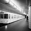 u-bahn train pulling in to ubahn station Berlin Germany by Joe Fox
