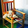 Vertical of dog in kid chair. Print by Sylvie Bouchard