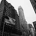 view of pennsylvania bldg nelson tower and US flags flying on 34th street from 1 penn plaza nyc by Joe Fox