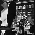 Window Shopping Cowboy by Photo Researchers