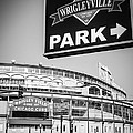Wrigleyville Sign And Wrigley Field In Black And White by Paul Velgos