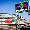 Wrigleyville Sign And Wrigley Field In Chicago by Paul Velgos