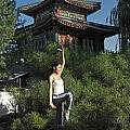 A Chinese Woman In Her 20s To 30s Doing by Justin Guariglia