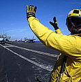 An Aviation Boatswains Mate Directs by Stocktrek Images