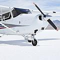 Cessna Aircraft On Bonneville Salt Flats by Paul Edmondson