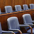 Empty Jury Seats In Courtroom by Jeremy Woodhouse