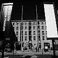Entrance To The Albert Dock And Beatles Museum Liverpool Merseyside England Uk by Joe Fox