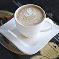 Latte With a Leaf Design Print by Jaak Nilson