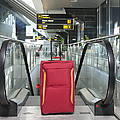 Luggage At The Top Of An Escalator by Jaak Nilson