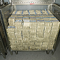 Us Dollar Bills In A Bank Cart by Adam Crowley