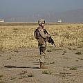 U.s. Marine Patrols A Wadi Near Kunduz by Terry Moore