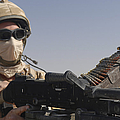 A British Army Soldier Mans A Machine by Andrew Chittock