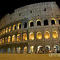 Coliseum Illuminated At Night. Rome by Bernard Jaubert