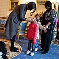 First Lady Michelle Obama Greets by Everett