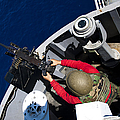 A Sailor Fires A .50-caliber Machine by Stocktrek Images