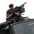 A Belgian Paratrooper Manning A Fn Mag by Luc De Jaeger