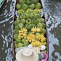 A Boat Laden With Fruit At The Damnoen Saduak Floating Market In Thailand by Roberto Morgenthaler