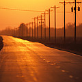 A Country Highway Fades Into The Sunset by Joel Sartore