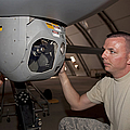 A Crew Chief Works On Mq-1 Predators by HIGH-G Productions