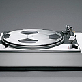 A Disk With A Soccer Print On A Record Player by Benne Ochs