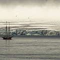 A Double-masted Sailboat Floats Near An by Norbert Rosing