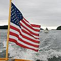 A Flag Waves On The Stern Of A Maine Print by Heather Perry