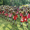 A Group Of New Guinean Men Performing by Klaus Nigge
