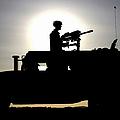 A Gunner Mans An Mk-19 40mm Machine Gun by Stocktrek Images