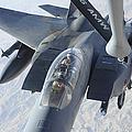 A Kc-135 Stratotanker Refuels An F-15e by Stocktrek Images