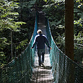A Man Walks Across A Suspension Bridge by Taylor S. Kennedy
