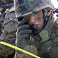 A Marine Communicates Over The Radio by Stocktrek Images