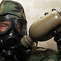 A Marine Drinks Water From A Canteen by Stocktrek Images